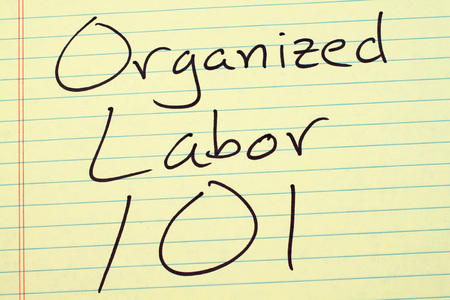 collective bargaining: The words Organized Labor 101 on a yellow legal pad