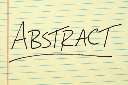 The word Abstract underlined on a yellow legal pad