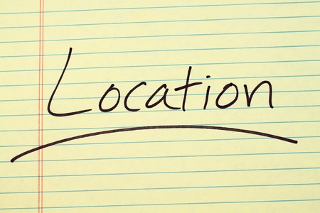 The word Location underlined on a yellow legal pad Stock fotó
