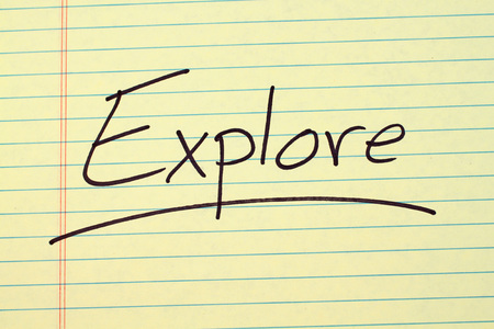 The word Explore underlined on a yellow legal pad Stock Photo