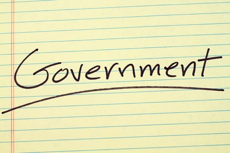 The word Government underlined on a yellow legal pad