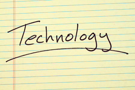 The word Technology underlined on a yellow legal pad