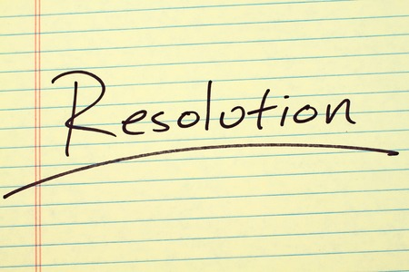 The word Resolution underlined on a yellow legal pad Stock fotó