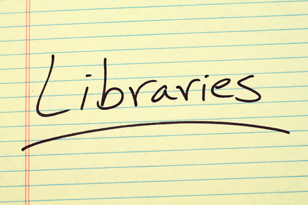 The word Libraries underlined on a yellow legal pad