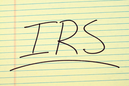 politic: The word IRS underlined on a yellow legal pad Stock Photo