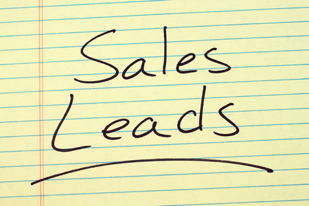 The word Sales Leads underlined on a yellow legal pad Stock Photo