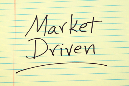 The word Market Driven underlined on a yellow legal pad