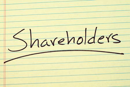 単語「株主」黄色リーガル パッドの上下線 写真素材 - 88128369