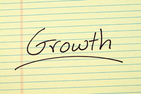 The word Growth underlined on a yellow legal pad