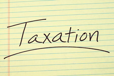 governement: The word Taxation underlined on a yellow legal pad