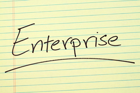 The word Enterprise underlined on a yellow legal pad Stock fotó