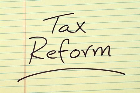 governement: The word Tax Reform underlined on a yellow legal pad Stock Photo