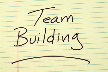 The word Team Building underlined on a yellow legal pad Stock fotó