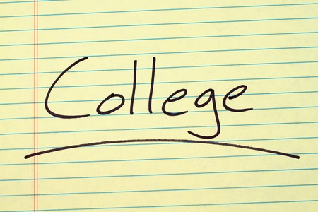 The word College underlined on a yellow legal pad Stock Photo