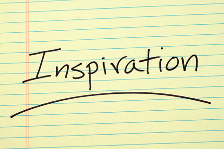 The word Inspiration underlined on a yellow legal pad Stock fotó