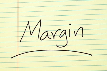 The word Profit Margin underlined on a yellow legal pad Stock fotó - 87710024