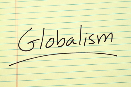 The word Globalism underlined on a yellow legal pad