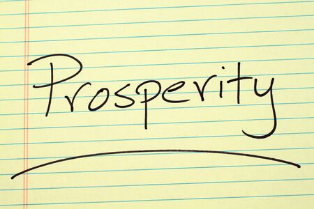 The word Prosperity underlined on a yellow legal pad Stock fotó