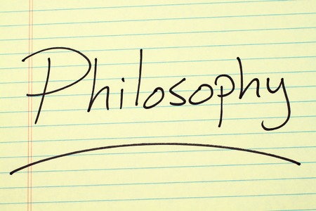 The word Philosophy underlined on a yellow legal pad