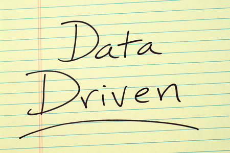 The word Data Driven underlined on a yellow legal pad