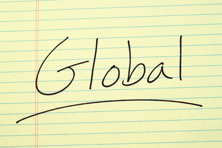 The word Global underlined on a yellow legal pad Stock fotó