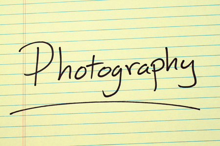 The word Photography underlined on a yellow legal pad Stock Photo