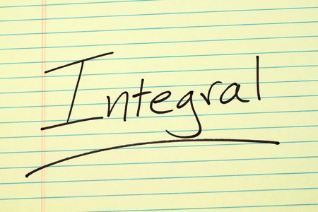 The word Integral underlined on a yellow legal pad