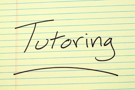 The word Tutoring underlined on a yellow legal pad