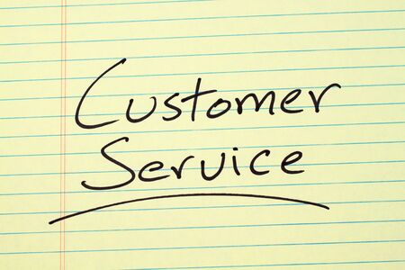The word Customer Service underlined on a yellow legal pad