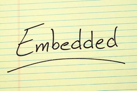 The word Embedded underlined on a yellow legal pad Stock fotó
