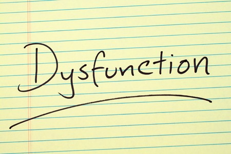 The word Dysfunction underlined on a yellow legal pad Stock fotó