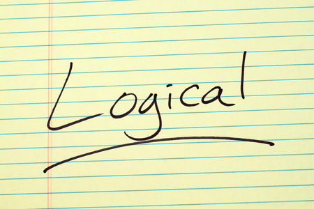 The word Logical underlined on a yellow legal pad