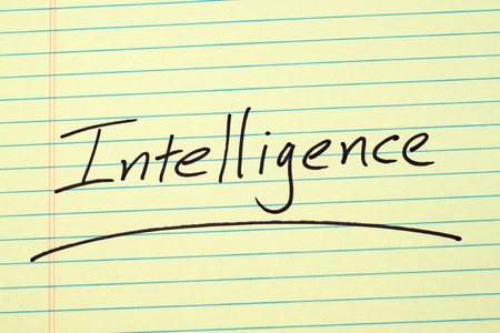 The word Intelligence underlined on a yellow legal pad Stock fotó
