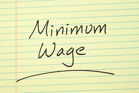The word Minimum Wage underlined on a yellow legal pad Stock fotó