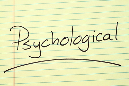 The word Psychological underlined on a yellow legal pad