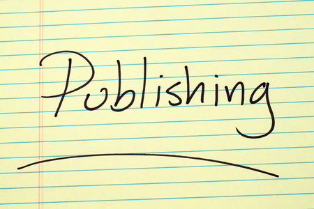 The word Publishing underlined on a yellow legal pad