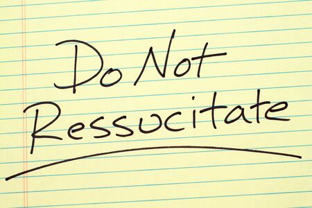 The word Do Not Ressucitate underlined on a yellow legal pad