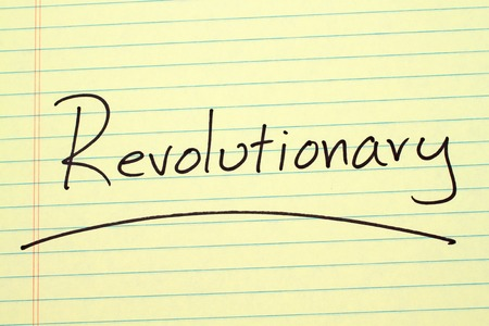 The word Revolutionary underlined on a yellow legal pad