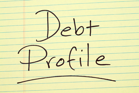 The word Debt Profile underlined on a yellow legal pad Stock Photo