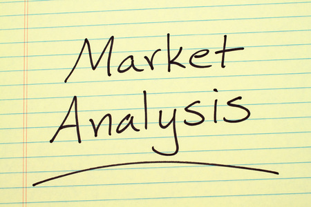 The word Market Analysis underlined on a yellow legal pad
