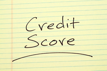 The word Credit Score underlined on a yellow legal pad Stock fotó
