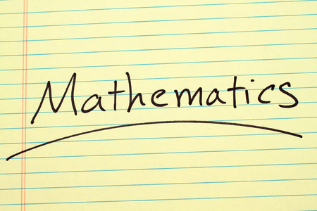 The word Mathematics underlined on a yellow legal pad