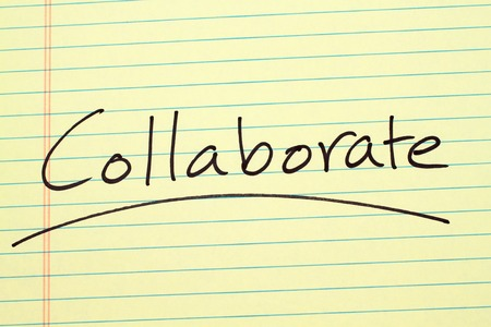The word Collaborate underlined on a yellow legal pad Stock fotó