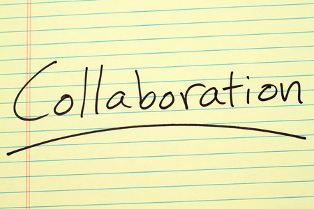 The word Collaboration underlined on a yellow legal pad