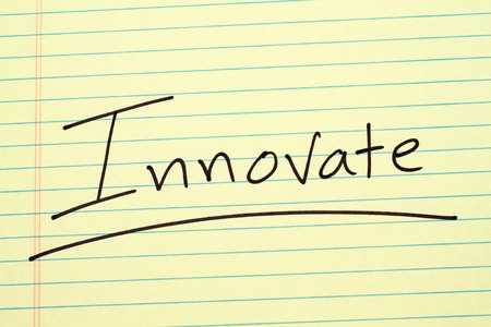 The word Innovate underlined on a yellow legal pad Stock fotó