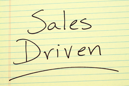 The word Sales Driven underlined on a yellow legal pad