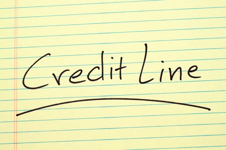 The word Credit Line underlined on a yellow legal pad