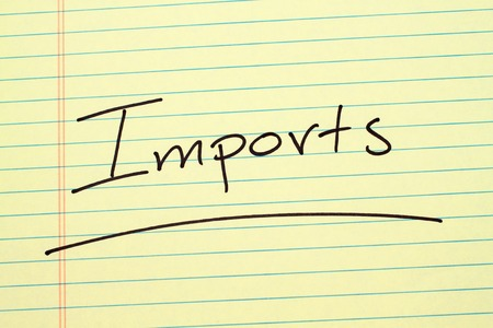 The word Imports underlined on a yellow legal pad Stock fotó