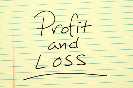 The word Profit And Loss underlined on a yellow legal pad Stock Photo