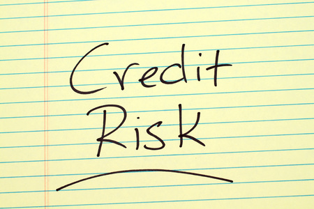 The word Credit Risk underlined on a yellow legal pad Stock Photo